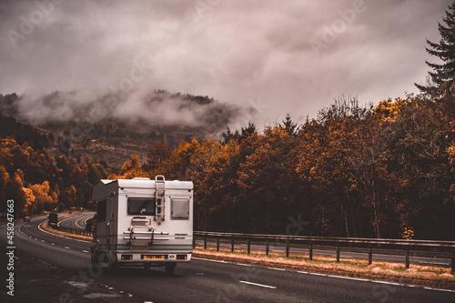 Fotografie, Tablou Campervan on the highway to Glencoe during Autumn season