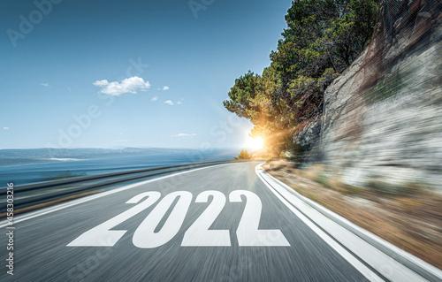 Fotografia, Obraz 2022 New Year road trip travel and future vision concept