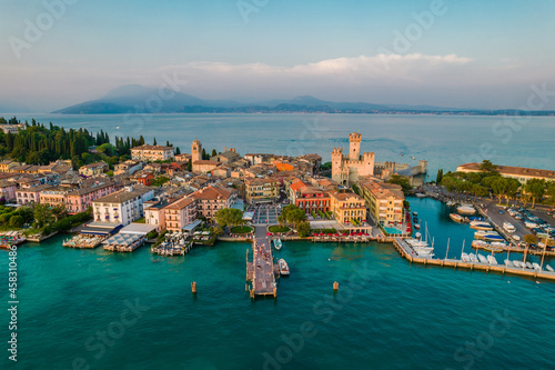 Fototapeta Aerial panoramic view of Sirmione city old town on lake Garda in Lombardy, Italy