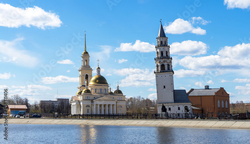 Leinwand Poster Leaning Tower of Nevyansk and Old Believers' church (domed) in spring day on the
