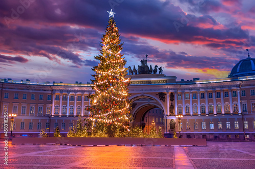 Saint Petersburg winter. Russia christmas. Arc de Triomphe sunset. Palace Square in winter evening. Christmas tree in front of Arc de Triomphe. Christmas tree with glowing garlands. Russia Holidays