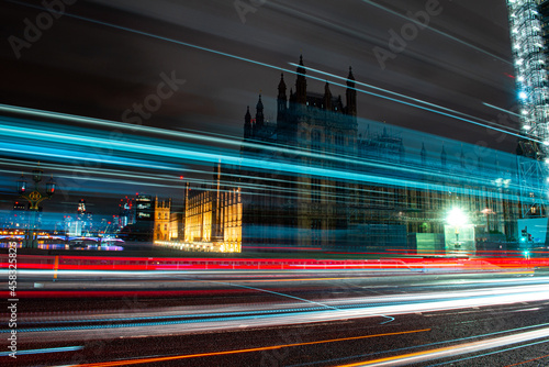 Obraz na plátně Light Trails On City Street By Buildings At Night In London