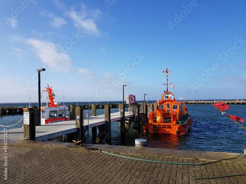 Obraz na plátně Orange motorboat near the pier in Baltic Sea, Poel island on a sunny day