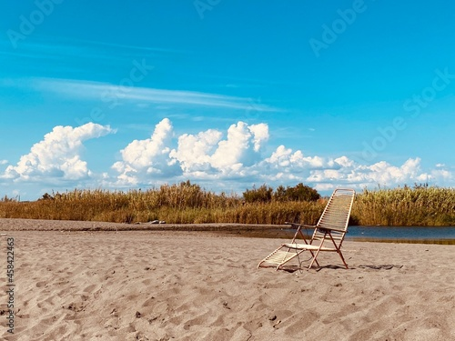 Foto Deck Chairs On Sand At Beach Against Sky
