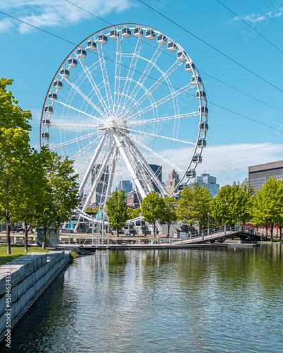 Fotografie, Obraz Ferris Wheel By River Against Sky