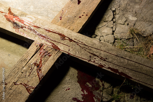 Blood drips on a wooden cross Fotobehang