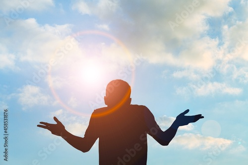 Young man rising on blue sky white clouds abstract background Fototapet