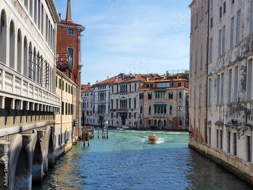 Fotografija A speedboat sails along one of the canals in Venice