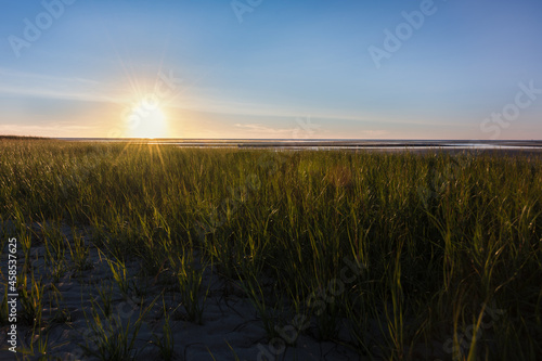 Canvas Print A sunset photograph on a beach during low tide