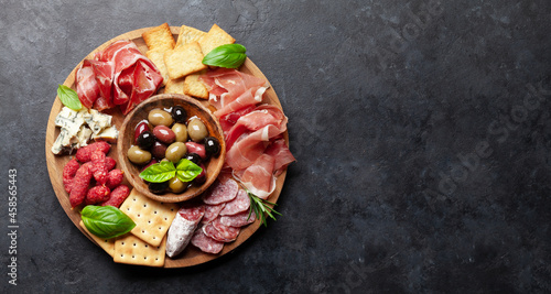 Fotografiet Antipasto board with prosciutto, salami, crackers, cheese, olives