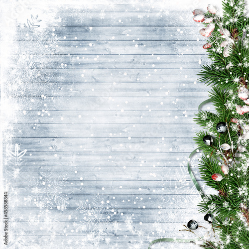 Obraz na plátně Christmas firtree with holly, snowfall on wooden white board
