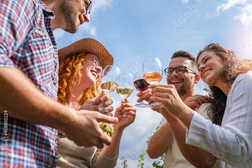 Happy friends having fun drinking wine at winery vineyard - Friendship concept w Fototapet
