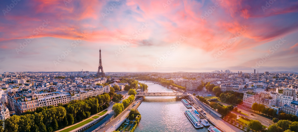 Paris aerial panorama with river Seine and Eiffel tower, France. Romantic summer holidays vacation destination. Panoramic view above historical Parisian buildings and landmarks with sunset sky