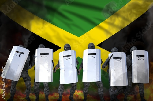 Wallpaper Mural Jamaica police special forces in heavy smoke and fire protecting law against rev