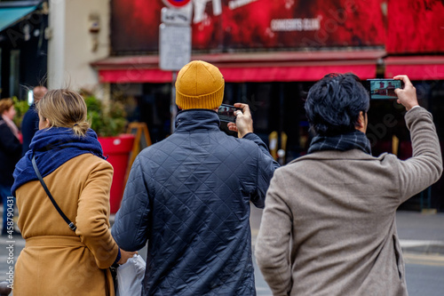 Tourists photographing the Moulin Rouge on mobile phones, Boulevard de Clichy, P Fotobehang