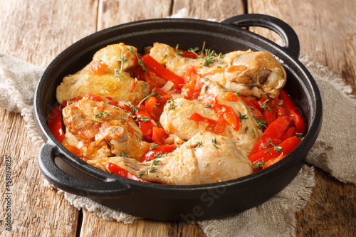 Fototapeta Basque Chicken or Poulet Basquaise with vegetables close up in the pan on the table