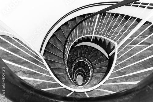 Obraz na plátně Sprial staircase forming a beautiful pattern like an open lotus flower - black a
