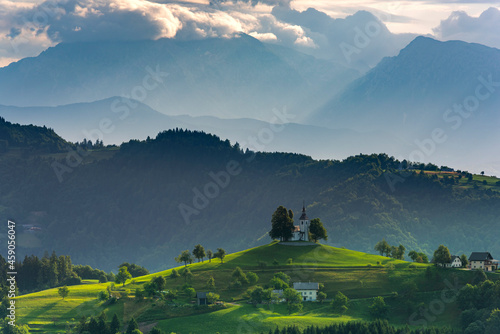Fototapeta Lonely Church Stand Out on Hilltop in Alpine Landscape