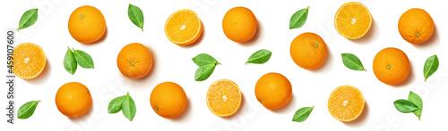 Fotografiet Fruit pattern arranged of oranges and orange leaves on white background