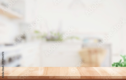 Canvas wooden top table with blurred kitchen room interior for product display montage