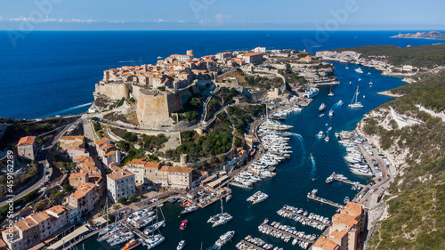 Fotografiet Aerial view of the marina and cape of Bonifacio in the south of the island of Co