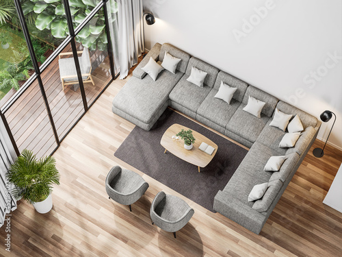 Top view of modern living room with tropical style garden view 3d render,The Rooms have wooden floors ,decorate with gray fabric sofa, Overlooks wooden terrace and green garden.