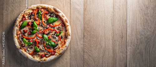 Fotografie, Obraz Pepperoni pizza with hunters sausages, mushrooms, red peppers and fresh basil on