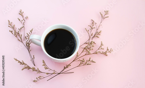 Tela White ceramic cup with black coffee put on background