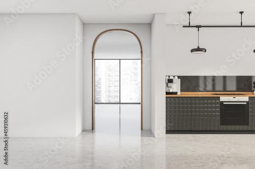 Billede på lærred White space with stylish kitchen and archway