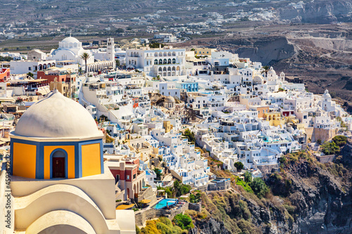Fotografiet Catholic Cathedral of Saint John the Baptist with aerial view of Thira on Santorini island, Greece