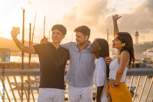 Multiracial friends taking selfie on embankment Fototapet