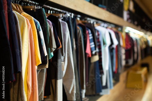 Variety of male wear on hangers in clothing showroom