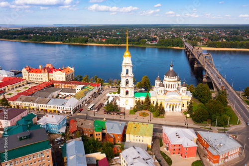 Vászonkép Aerial panoramic view of Rybinsk cityscape overlooking automobile bridge across Volga river and medieval Spaso-Preobrazhensky Cathedral with belfry in historical part of city, Yaroslavl region