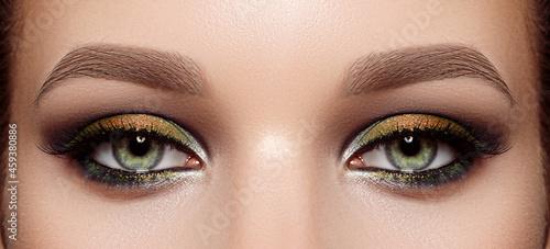 Fotografiet Closeup Macro of Woman Face with Green Eyes Make-up