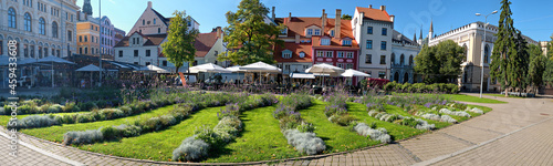 Fotografie, Obraz Livu square in Riga, Latvia, panoramic image with wave pattern of flowerbeds on foreground