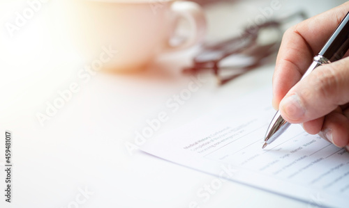 Cuadros en Lienzo Close-up of Hand using writing pen with questionnaire or paperwork survey question filling in business company personal information form checklist document