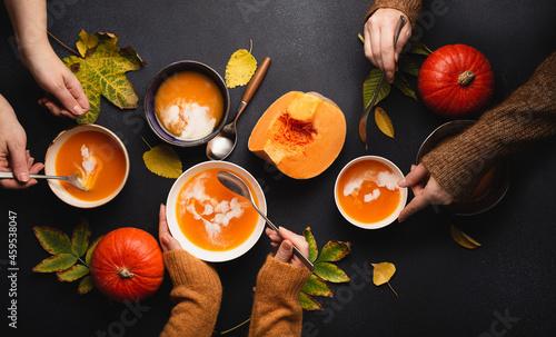 Top view people eating autumn pumpkin soup