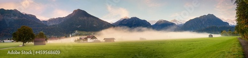 Fotografering foggy morning scenery, tourist resort Oberstdorf landscape with mountains and gr