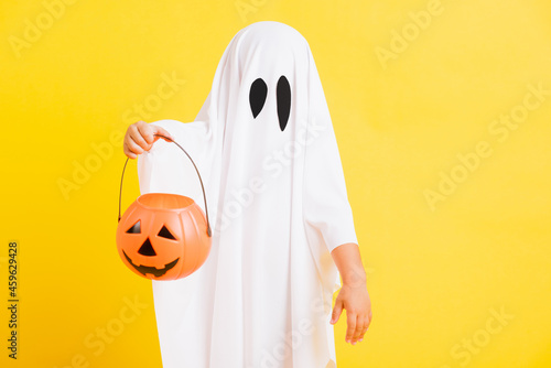 Photo Funny Halloween Kid Concept, little cute child with white dressed costume hallow