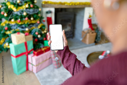 Caucasian woman using smartphone with copy space at christmas time