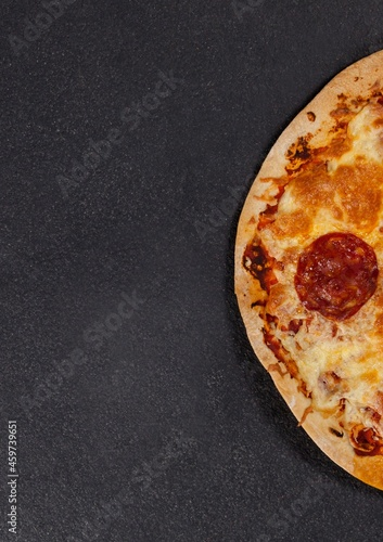 Composition of close up of fresh pizza on gray background