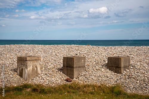 Fototapeta Anti-tank sea defences from the second world war on Kingston Beach near Spey Bay