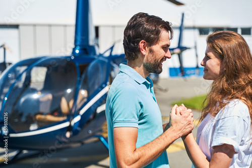 Loving couple looking at each other at heliport Fototapet