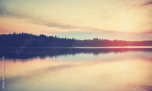 Lake at sunset, color toning applied.
