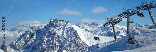 Fotografie, Obraz Panorama winter landscape with a ski lift and snowy peaks in the Alps, France