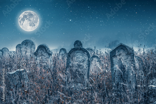 Foto Spooky Cemetery and full moon. Halloween background