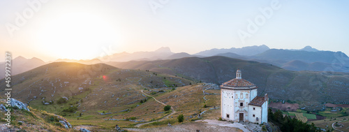 Fotografie, Tablou The small octagonal chapel near Rocca Calascio castle ruins at sunset in backlight, landmark in the Gran Sasso National Park, Abruzzo, Italy