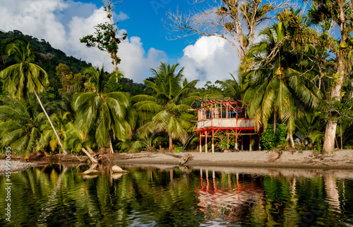 An abandoned shack being reflected in the water on the beach at Grand Riviere on the tropical Caribbean island of Trinidad Fototapet