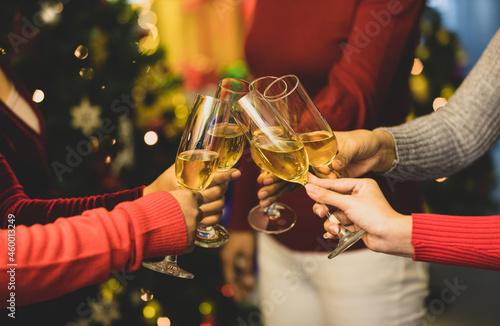 Fotografie, Obraz Women on sweater clink glass of ิิbeverage together to start holiday event of jo