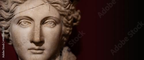 Fotografie, Obraz closeup of woman antique statue face on dark background